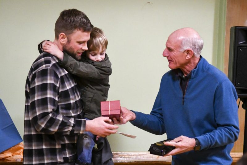 Jeff Peak receives Golden Apple from Ken Pastega
